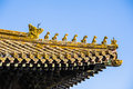 Immortal and beasts on the eaves of the building in forbidden city beijing Stock Photo