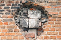 Immured hole big in the old brick wall by different block pieces Stock Image