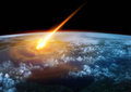 Impact earth a meteor glowing as it enters the s atmosphere Stock Image