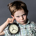 Impatient young boy with a dark look reproaching alarming deadlines Royalty Free Stock Photo