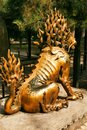 Gilded unicorn sit in the Imperial Garden of the Forbidden City. View from the back. Beijing
