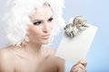 Impish winter beauty holding fancy present Royalty Free Stock Photo