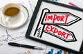Import and export signpost hand drawing on tablet pc concept Stock Photo