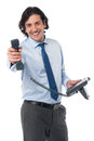 Important business call for you boss male assistant handing over phone receiver to his Royalty Free Stock Images