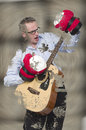 Impossible to do businessmen playing on guitar wearing boxing gloves splashed in a mud Stock Photography