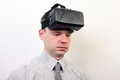 An impressed dizzy flabbergasted man wearing oculus rift vr virtual reality headset a he s with the game amused and maybe he had a Stock Photography