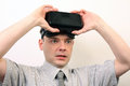 An impressed relieved flabbergasted man wearing oculus rift vr virtual reality headset a hes with the game dizzy amused and maybe Stock Photos