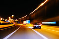 Impression style of picture of moving traffic on a motor way an at night Stock Images