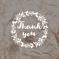 Imprint of the stamp Thank you on a crumpled kraft paper background.