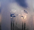 The imprint of two human palms on the sweaty glass Royalty Free Stock Photo