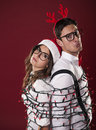 Imprisoned nerd couple have problems with christmas decoration Royalty Free Stock Photography