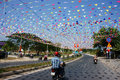 Imrpression with decoration to celebrate viet nam holiday phan rang jan impression on street people hang many string of small Stock Photography