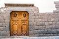Inca stonework et porte en bois Photographie stock