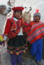 Incan children with llamas Royalty Free Stock Photo