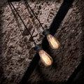 Incandescence lamp on brick grunge ceiling taken closeup Stock Image