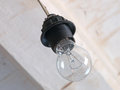 Incandescence lamp on a white ceiling background taken closeup Stock Image