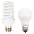Incandescent and helical fluorescent light bulbs two lamps compact isolated on white background Royalty Free Stock Image