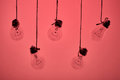 incandescent light bulbs hanging on a pink background Royalty Free Stock Photo