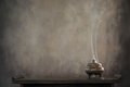 Incense burner on table Royalty Free Stock Photo
