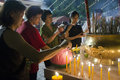 Incense devotees burnt sticks during prayers on the wesak eve Royalty Free Stock Photography