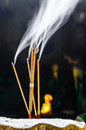 Incense with rising smoke or joss sticks Royalty Free Stock Images