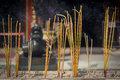 Incense sticks burning at a taoist temple of wong tai sin hong kong yellow Royalty Free Stock Photo