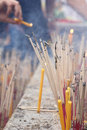 Incense sticks and candles in a Buddhist temple Stock Images