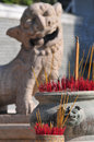 Incense w traditional lion rock sculpture background Stock Image