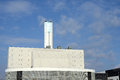 Incineration plant with chimney against blue sky Royalty Free Stock Photo