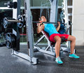Incline barbell bench press woman in multipower smith machine workout at gym Royalty Free Stock Photo