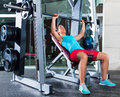Incline Barbell Bench Press woman in multipower Royalty Free Stock Photo