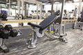 Incline bench in modern gym interior Royalty Free Stock Photo