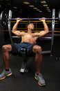 Incline bench press lifting weight lifter at the a barbell on an Stock Photo
