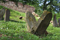 Inclined gravestones two interisting in jewish cemetery Royalty Free Stock Image