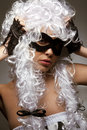 Incognito woman in ancient wig and mask Stock Photo