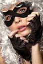 Incognito woman in ancient wig and mask Stock Photography