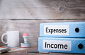 Income and Expenses. Two binders on desk in the office. Business background Royalty Free Stock Photo