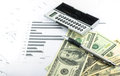 Income and outcome statement report with calculator, pen and usd Royalty Free Stock Photo