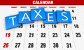 Income tax as a concept in the background calendar Royalty Free Stock Photos
