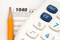 Income tax forms an form with a calculator and pencil Stock Image