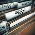 Income tax taxes concept files with close up and focus on the tab blur effect conceptual image suitable for illustration Stock Photo
