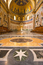 Incredible marble floor an italian church with an and mosaic in the church choir Stock Photo