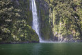 Incredible Stirling Falls with double rainbow, Milford Sound, Fi Royalty Free Stock Photo
