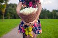 Incredibly beautiful large bouquet of white roses in the hands a young girl in colored dress Stock Photo