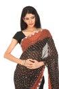 Indain woman in black designed sari Stock Photography
