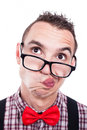 Indecisive nerd face closeup of man isolated on white background Stock Photo