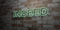 INDEED - Glowing Neon Sign on stonework wall - 3D rendered royalty free stock illustration Royalty Free Stock Photo