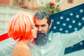 Independence day couple with flag Royalty Free Stock Photo
