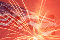 Independence day fireworks over united states flag Stock Photos