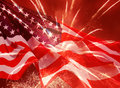 Independence day fireworks over waved united states flag Royalty Free Stock Photo